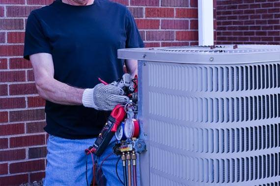 Man repairing an AC unit